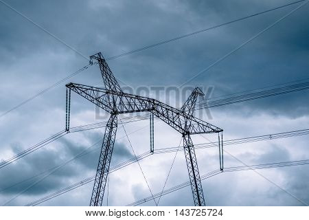 High voltage pillars on the background of blue sky