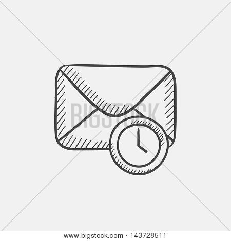 Envelope mail with clock sketch icon for web, mobile and infographics. Hand drawn vector isolated icon.