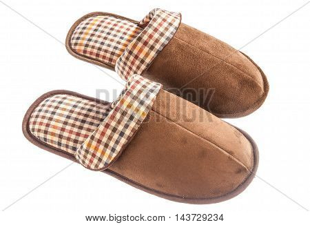 Beautiful brown slippers on an isolated white background