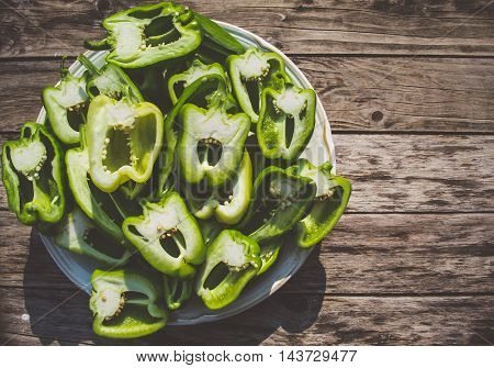 Fresh green pepper on the wooden table