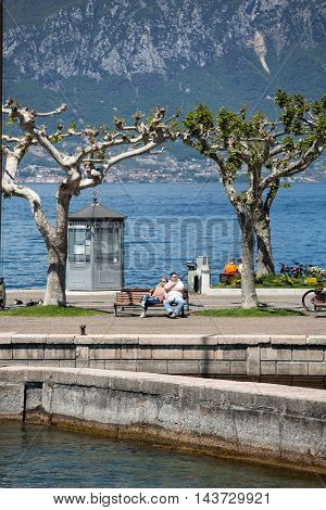 TORRI DEL BENACO, ITALY - MAY 4, 2016: Garda lake with promenade in Torri del Benaco Italy