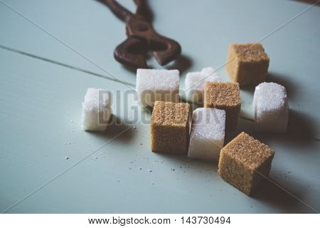 The sugar and old tool on the table