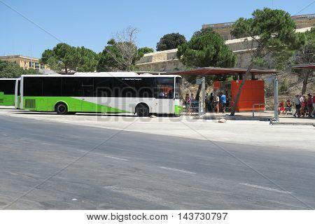 VALLETTA, MALTA - AUGUST 02 2016: A Malta Public Transport bus at Valletta bay. From 2015 all buses are modernized.