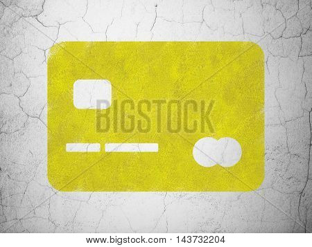 Finance concept: Yellow Credit Card on textured concrete wall background