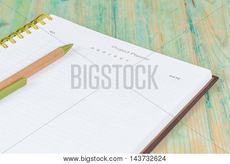 Closeup to agenda on project planner book