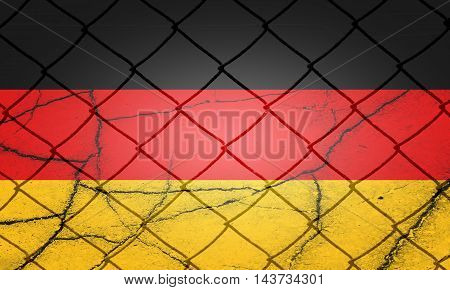 German flag, cracks and fence - Refugee crisis concept