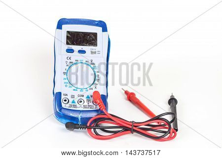 broken Digital multimeter on white background isolate