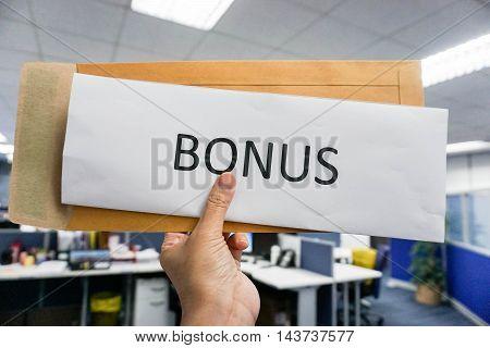 Concept of bonus by pulling paper of bonus from the envelope