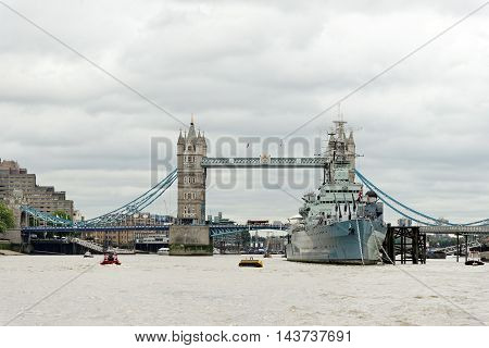 Tower Bridge a combined bascule and suspension bridge in London England built in 1886-1894. It has become an iconic symbol of London.