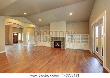 Spacious Empty Living Room Interior With Vaulted Ceiling