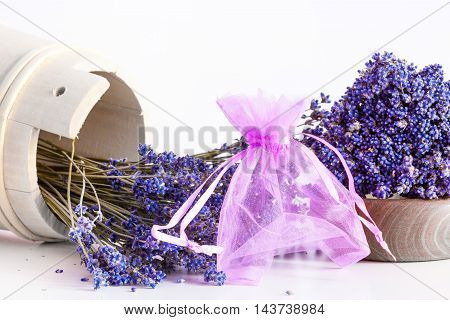 Making aroma bags bunch of dry wild mountain lavender flowers and wooden bowl