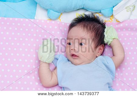 Little asian newborn with many rash on face
