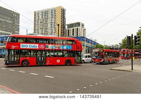 LONDON ENGLAND - JULY 8 2016: Busy traffic outside the dilapidated Elephant and Castle Shopping Centre in Southwark South London.