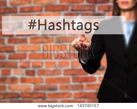 #hashtags - Businesswoman Hand Pressing Button On Touch Screen Interface.