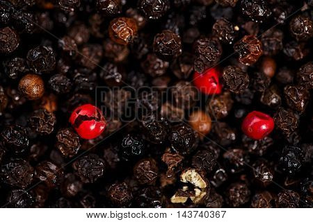 black and red peppercorns art backgroung