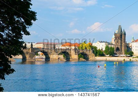 Charles Bridge, aka Karluv most, and Vltava river in Prague city centre on sunny summer day with blue sky, Czech Republic