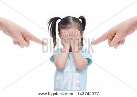 Little asian girl crying while parents scold her over white
