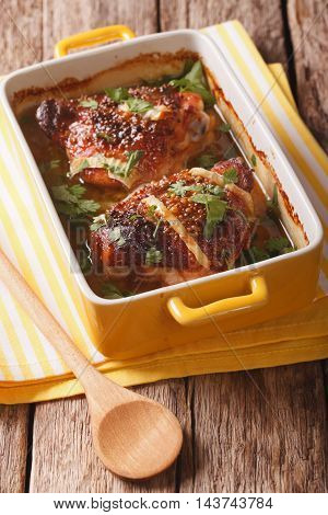 Tasty Chicken Thigh Baked With Honey And Mustard Close Up In Baking Dish. Vertical