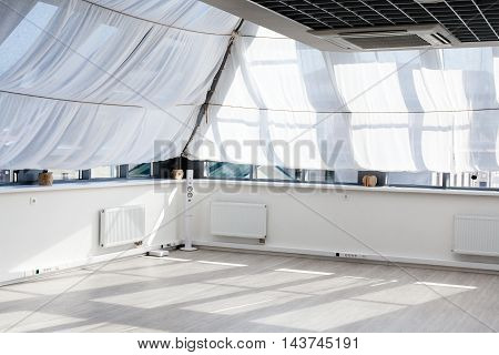 Interior of a room with big windows sunlight on the floor