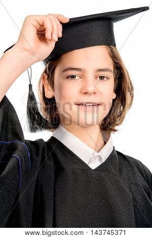 Happy boy graduating student wearing academic hat and a gown. Isolated over white background.