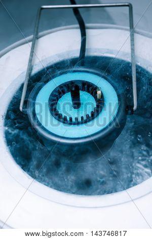 Cryostorage of sperm samples or oocytes in vitro fertilization process close up. Slow regimen of cryopreservation in liquid nitrogen. Equipment on laboratory of Fertilization IVF.