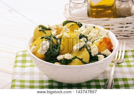 Salad with roasted potatoes , spinach and feta.