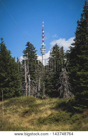 Lookout / TV transmitter tower on the peak of mountains