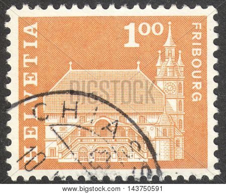 MOSCOW RUSSIA - CIRCA JUNE 2016: a post stamp printed in SWITZERLAND shows Town hall Fribourg Switzerland circa 1960