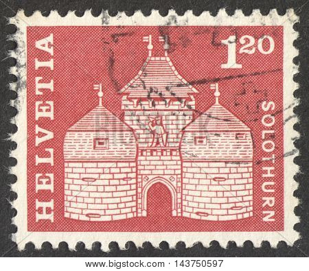 MOSCOW RUSSIA - CIRCA JUNE 2016: a post stamp printed in SWITZERLAND shows Basel gate Solothurn circa 1960