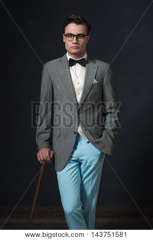 Retro 1920S Well Dressed Man In Suit With Glasses And Cane.