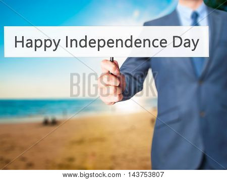 Happy Independence Day - Business Man Showing Sign