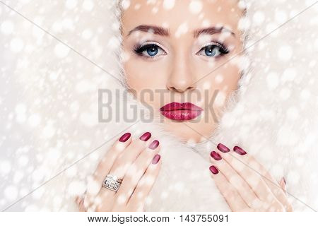 Winter Beauty. Woman with red lips and Snow