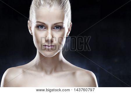 Portrait of a beautiful woman on dark background