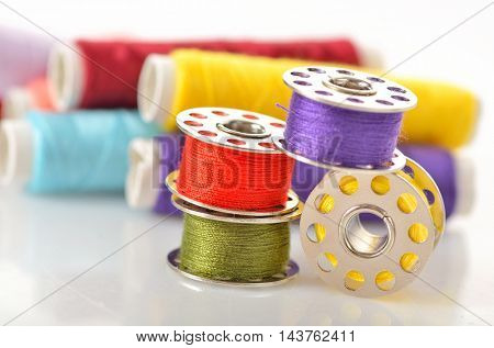 Colored bobbins for machine sewing and threads