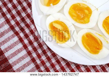 Boiled Eggs In White Plate On The Red Napkin