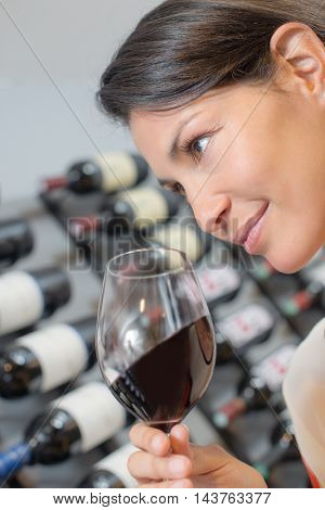 Lady holding glass of red wine
