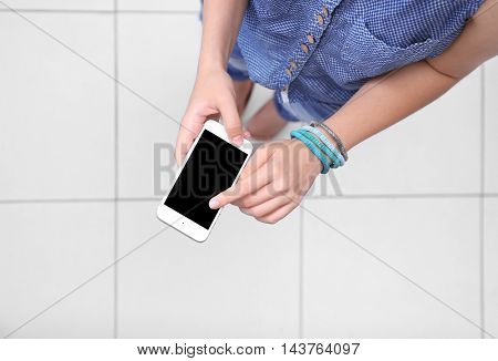 Woman with cellphone, top view