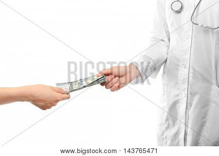 Female doctor getting money on white background. Corruption concept