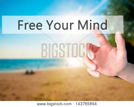 Free Your Mind - Hand Pressing A Button On Blurred Background Concept On Visual Screen.