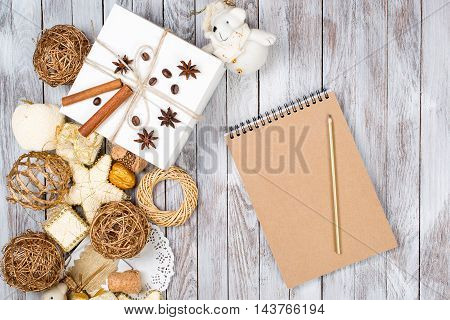 Christmas decoration card and pencil over the wooden background. Winter holidays concept. Space for text.