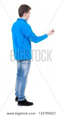 back view of writing business man. Rear view people collection.  backside view of person. Isolated over white background. Curly boy in blue jacket stands sideways and draws.