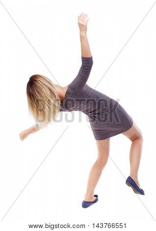 Balancing young woman.  or dodge falling woman. Rear view people collection.  backside view of person.  Isolated over white background. Blonde in violet short dress falls on his back.