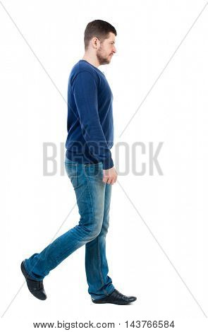 Back view of going  handsome man. walking young guy . Rear view people collection.  backside view of person.  Isolated over white background. bearded man in blue pullover passes by the viewer.