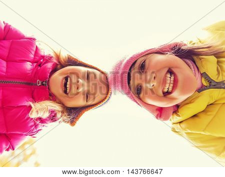 childhood, leisure, friendship and people concept - happy girls faces outdoors