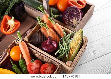 Fresh vegetables in wooden boxes