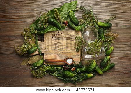 Preparation of cucumbers for homemade preserving on wooden background