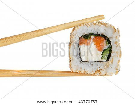 Tasty sushi roll with wooden chopsticks on white background