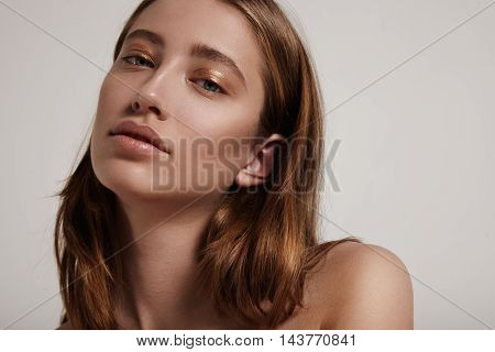 Blondy Woman With Golden Liner On Eyelid