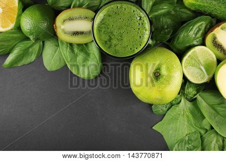 Tasty smoothie drink with vegetables and fruits on table