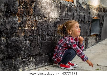 Little Beautiful Girl Near Brick Wall